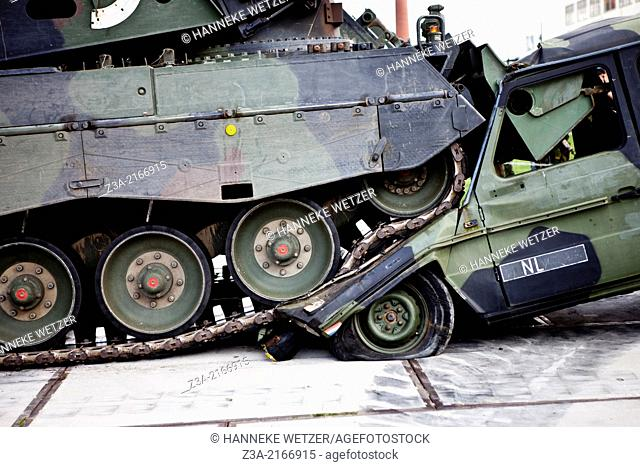 Tank crushing a jeep at the 200 years of land forces anniversary