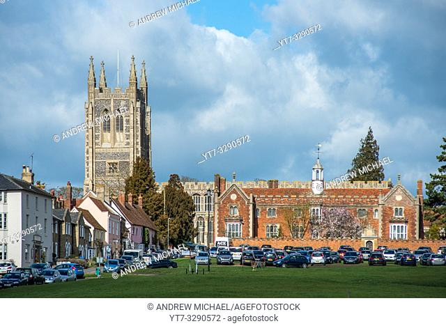 Hospital of the Holy and Blessed Trinity with Holy Trinity Church to the rear, in the village of Long Melford, Suffolk, East Anglia, UK