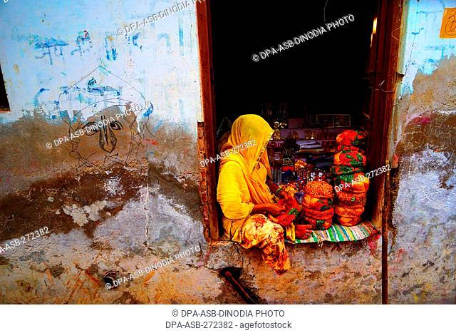 Woman selling caps, Nandgaon, Mathura, Uttar Pradesh, India, Asia