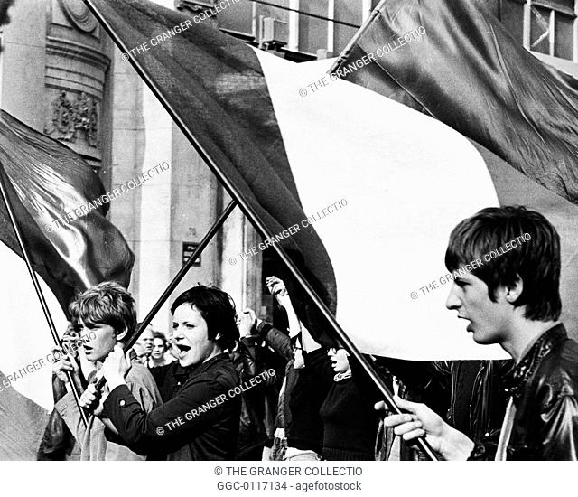 PARIS STUDENT REVOLT, 1968.University students marching through the streets of Paris, France, carrying banners and shouting slogans