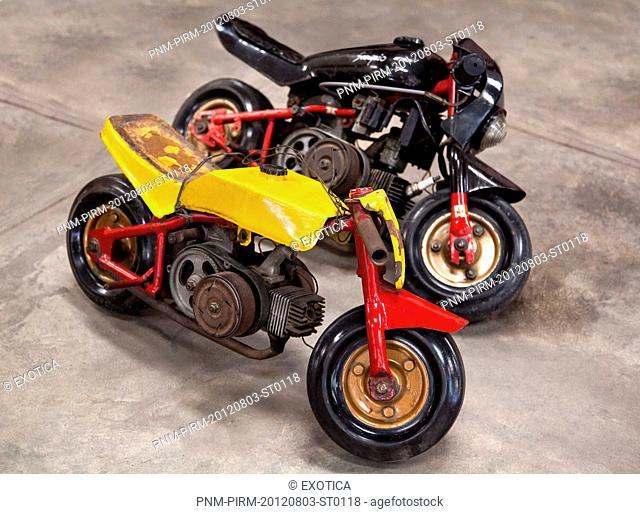 Mini motorcycles in a museum, Sudha Car Museum, Hyderabad, Andhra Pradesh, India