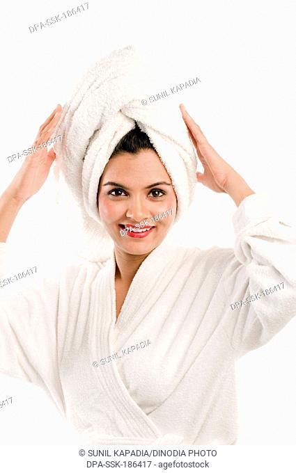South Indian girl wearing white turkish bathrobe Pune Maharashtra India Asia MR#686M