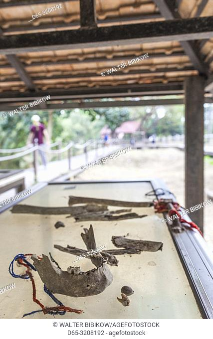 Cambodia, Phnom Penh, The Killing Fields of Choeung Ek, mass grave with human jawbone in former Khmer Rouge Prison camp