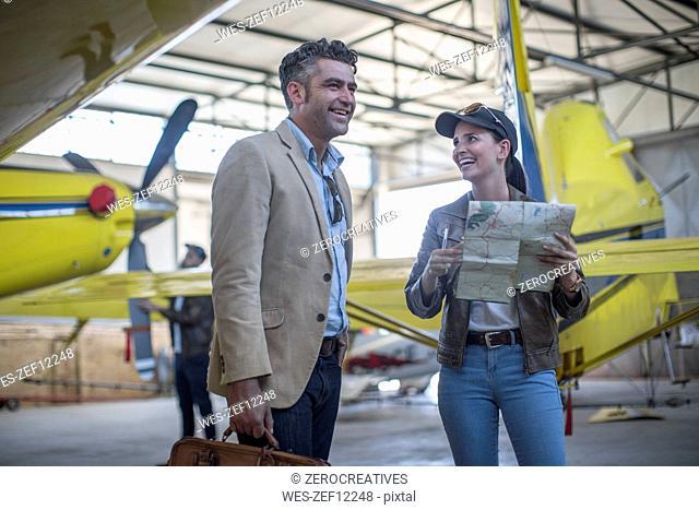 Female pilot talking to business client