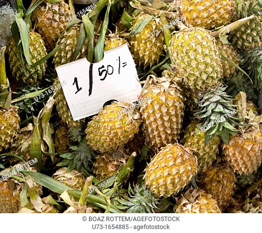 Freshly harvested pineapples arrive to the colorful market in Nuwara Eliya, Sri Lanka