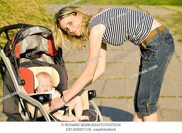 woman with baby sitting in pram