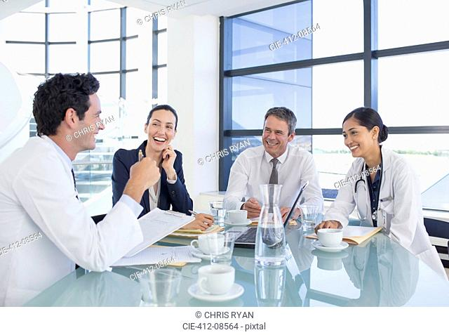 Doctors and business people talking in meeting