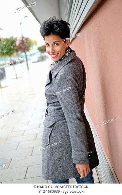 Exterior portrait of attractive young short haired woman