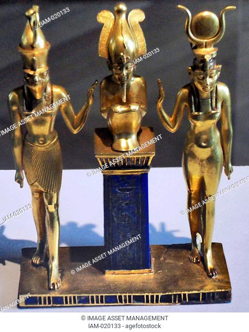 three gods statuette for King Osorkon II depicts the family of the god Osiris Osiris is flanked by Horus left and Isis right