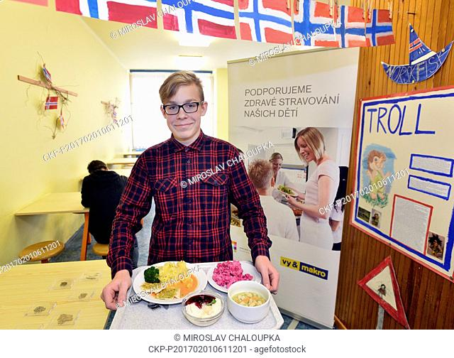 A student gets the lunch in the school canteen in 15th elementary school in Pilsen, Czech Republic, that serve Norwegian cuisine, Wednesday, February 1st, 2017