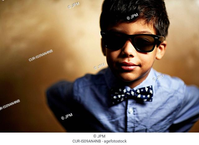 Boy wearing sunglasses and bow tie