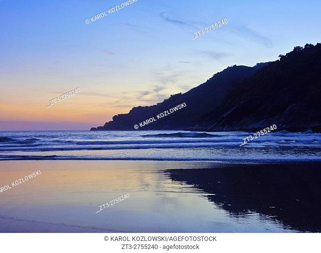 Brazil, State of Sao Paulo, Ilhabela Island, Bonete Beach during the sunset.