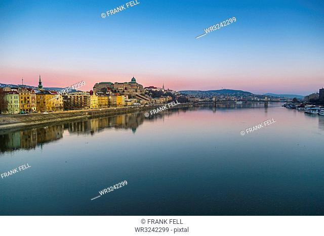 View of Budapest Castle reflecting in the Danube River during early morning, UNESCO World Heritage Site, Budapest, Hungary, Europe