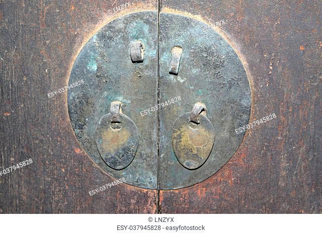 metal decorations on a brown door
