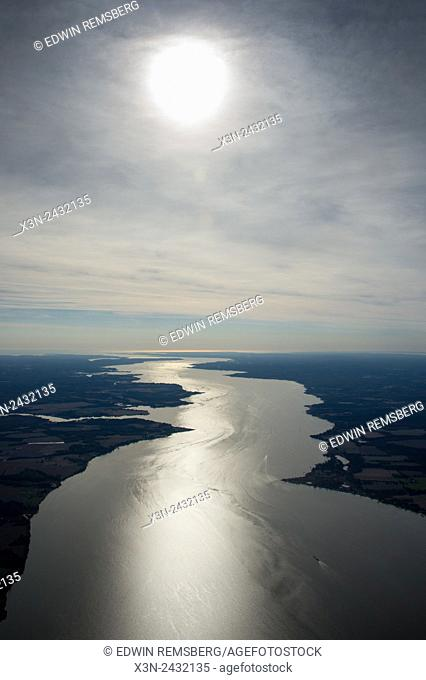 Aerial of river, showing the sun's reflection as a glowing shine in the water