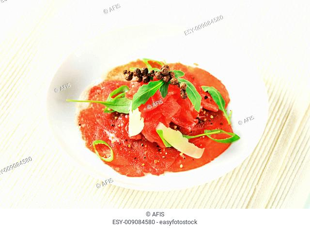 Beef carpaccio with Parmesan and salad greens