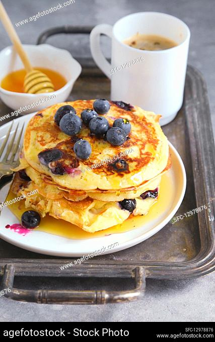 Blueberry pancakes served with honey and barley coffee