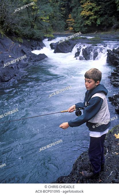 Cowichan River, young boy fishes pool, Vancouver Island, British Columbia, Canada