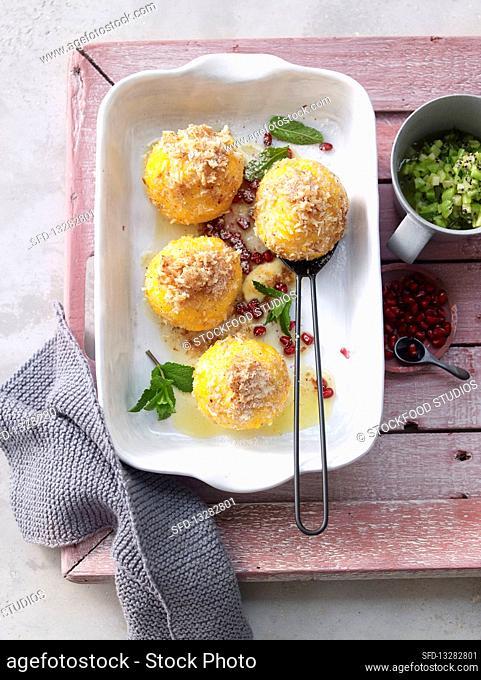 Polenta and coconut dumplings with kiwi and honey salsa
