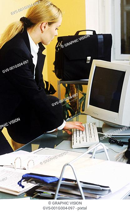 Young businesswoman working on a computer