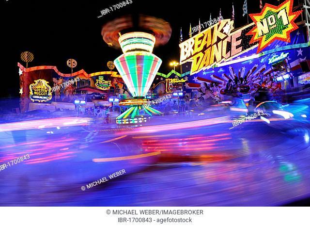 Breakdance ride at night, carousel, motion blur, Cannstatter Wasen or Volksfest, Stuttgart Beer Festival, Wasen, Bad Cannstatt, Stuttgart, Baden-Wuerttemberg