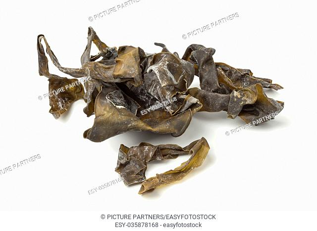 Heap of dried kelp on white background