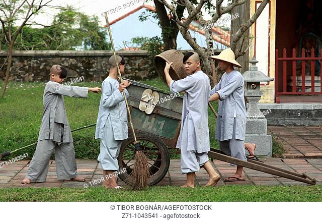 Vietnam, Hue, Thien Mu Pagoda, young monks gardening