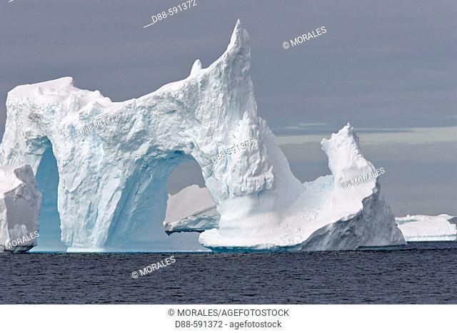 Double iceberg arch. Antartic Peninsula