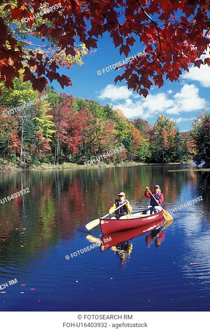 canoeing, canoe, Vermont, VT, Mother and daughter paddling a red canoe on Green River Reservoir in Hyde Park in the fall