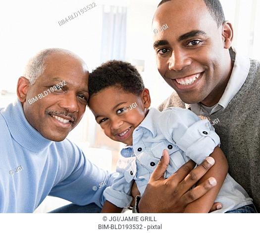 African American grandfather smiling with son and grandson