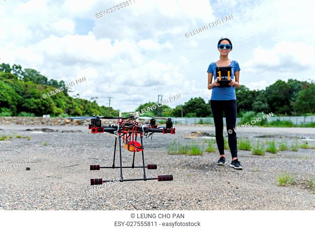Woman control the drone at outdoor