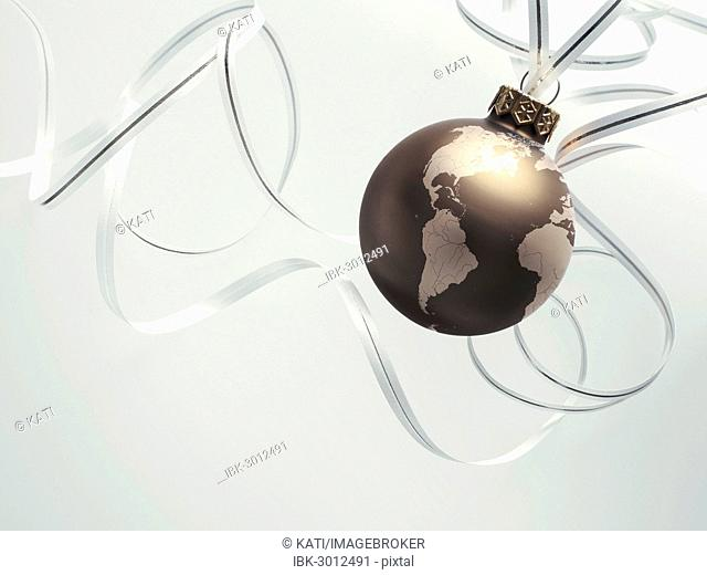 Christmas ball as a globe with North America, South America, parts of Africa and Europe