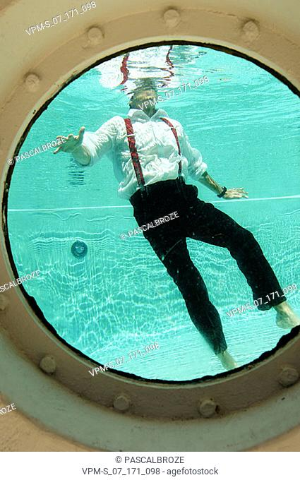 Mature man trapped in a swimming pool
