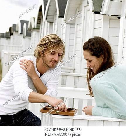 A young couple playing back gammon Skane Sweden