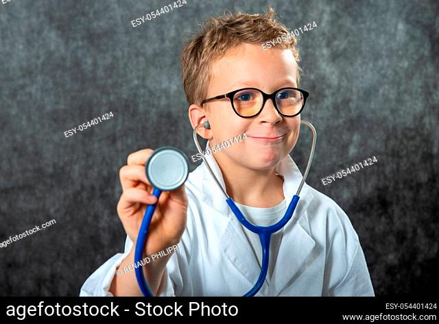 Cute kid boy wear medical uniform playing doctor, a portrait
