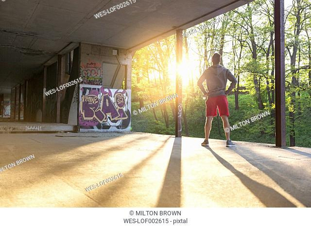 Young athletic man standing at underpass