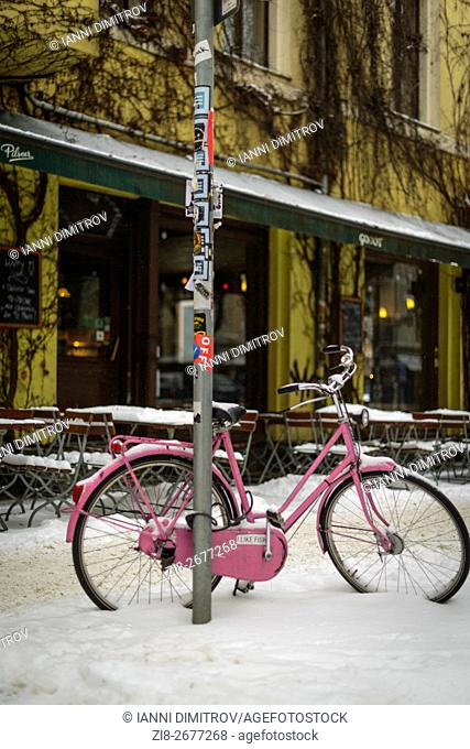 East Berlin,Germany-Bycicle in the snow in the gentrified urban district of Prenzlauer Berg