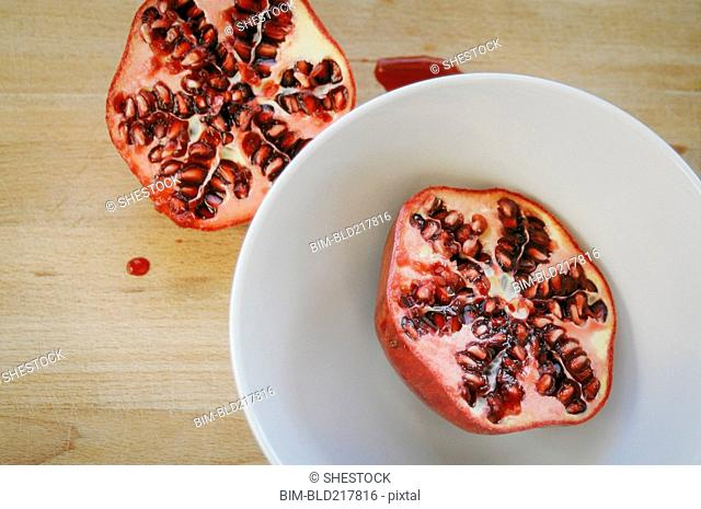 Close up of halved pomegranate on plate