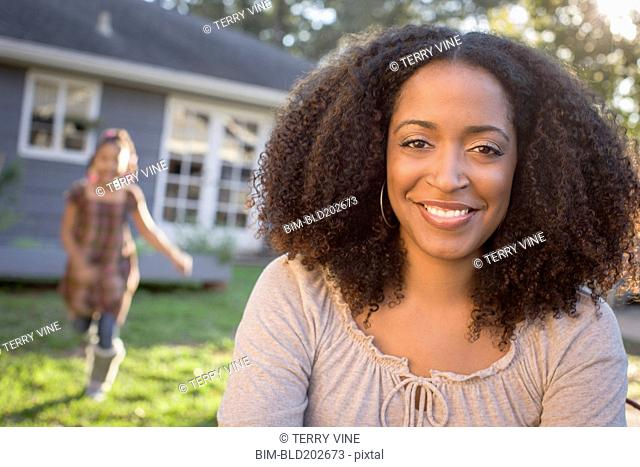 African American mother and daughter in backyard