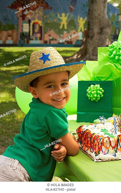 Portrait of a boy wearing a cowboy hat at a birthday party