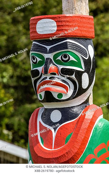Totem poles in the cemetery of the First Nations Kwakwaka'wakw people in Alert Bay, British Columbia, Canada