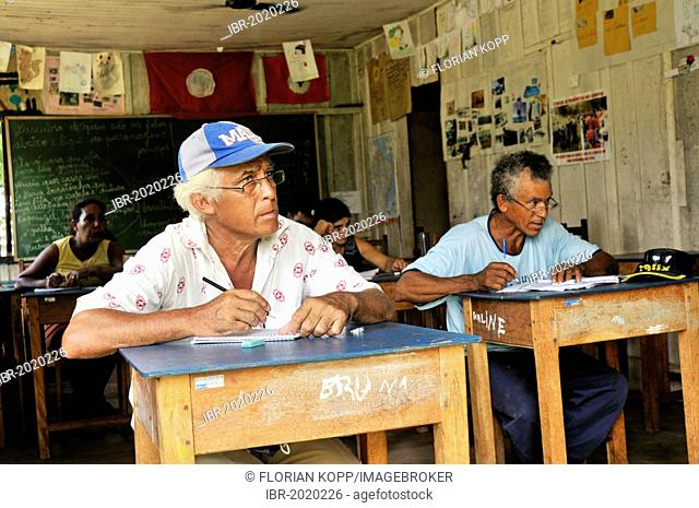 Adult education, adult men learning how to read and write at the village school of the Acampamento 12 de Otubro landless camp