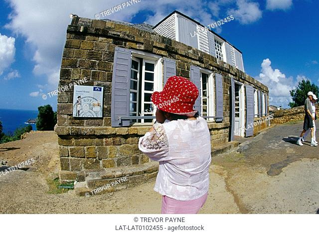 Admiral Nelson's Dockyard. Guard house. C18 buildings. Woman taking photograph