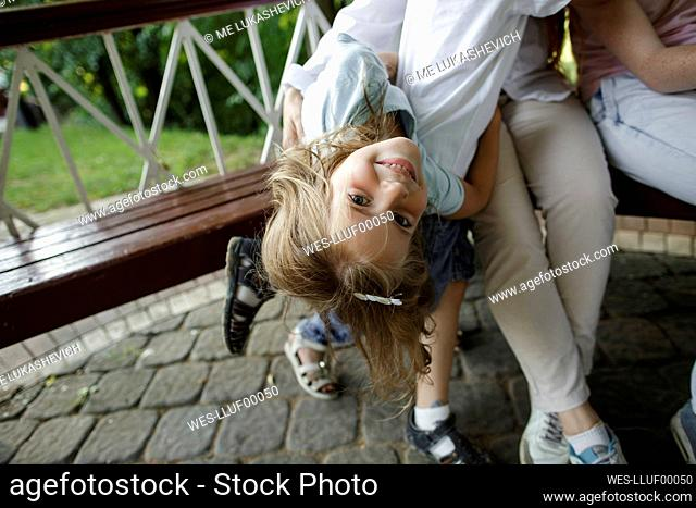 Smiling girl with her family on bench