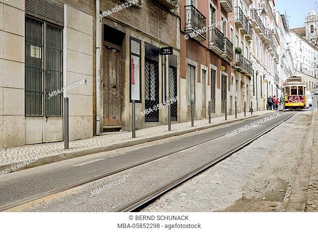 Street flight in Lisbon, at the end there stands of a tram