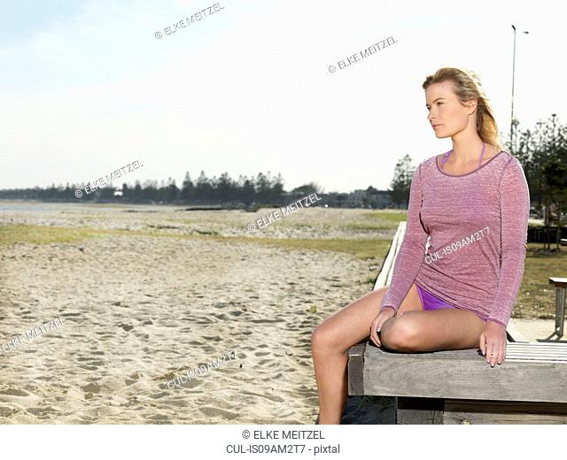 Young woman gazing from pier, Altona, Melbourne, Victoria, Australia