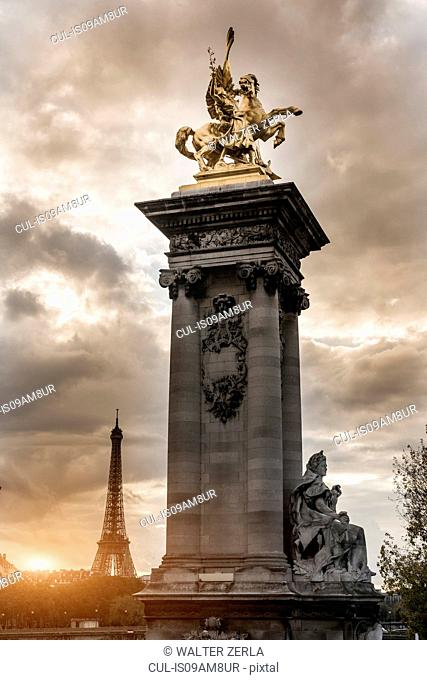 Statue on Pont Alexandre III (bridge), Eiffel Tower in background, Paris, France