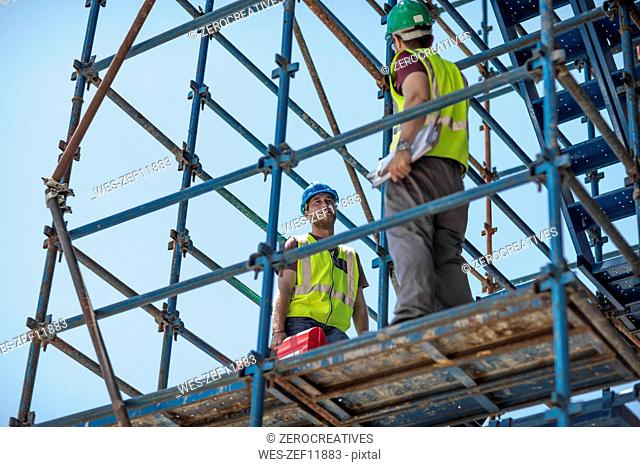 Construction workers standing on construction site