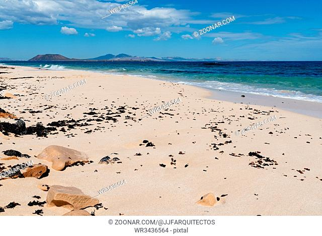 Scenic view of Dunes of Corralejo National Park. Lanzarote island on background