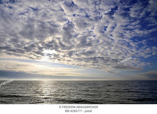 Cloudy sky, cloud formations in front of the setting sun, Baltic Sea, Western Pomerania Lagoon Area National Park, Mecklenburg-Western Pomerania, Germany